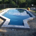 In-ground swimming pool installed by New England Landscaping in Spencer, MA